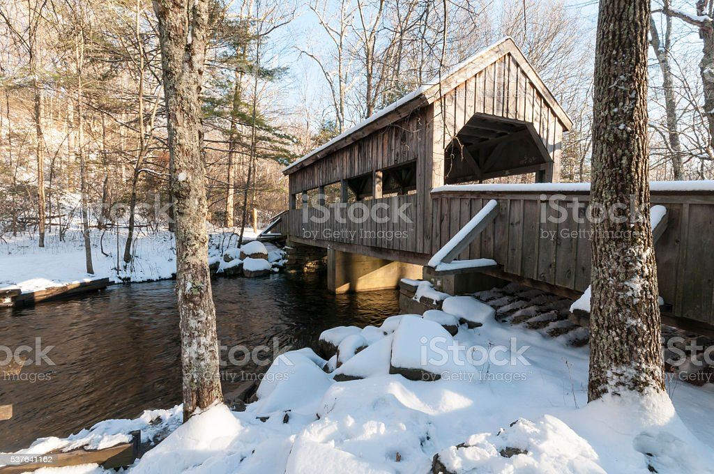 Covered bridge after snow stock photo