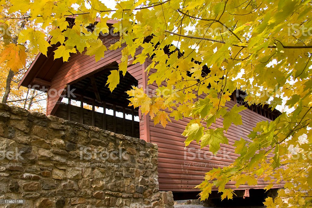 Covered Bridge and Yellow Autumn Leaves royalty-free stock photo
