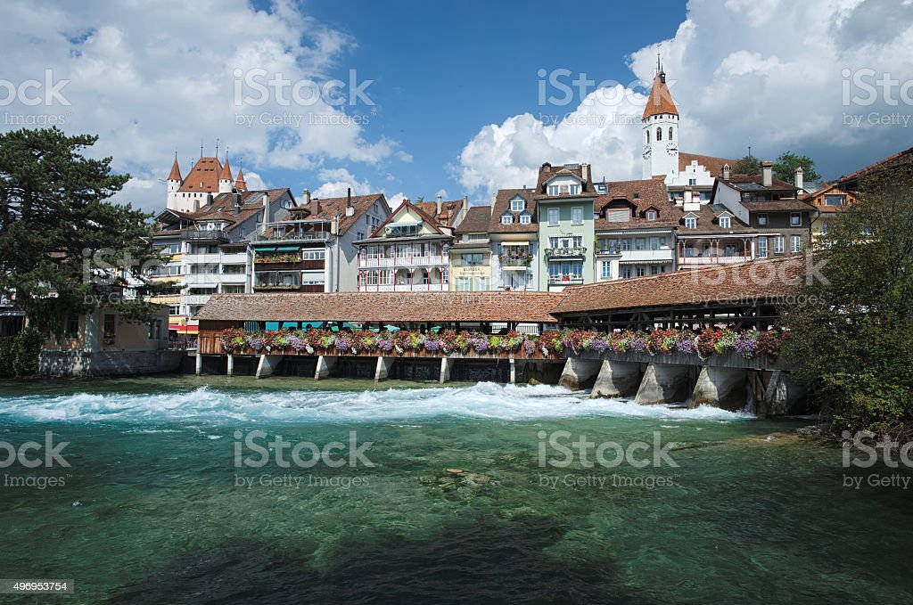 Covered bridge, church, castle and river view in Thun (Switzerland) stock photo