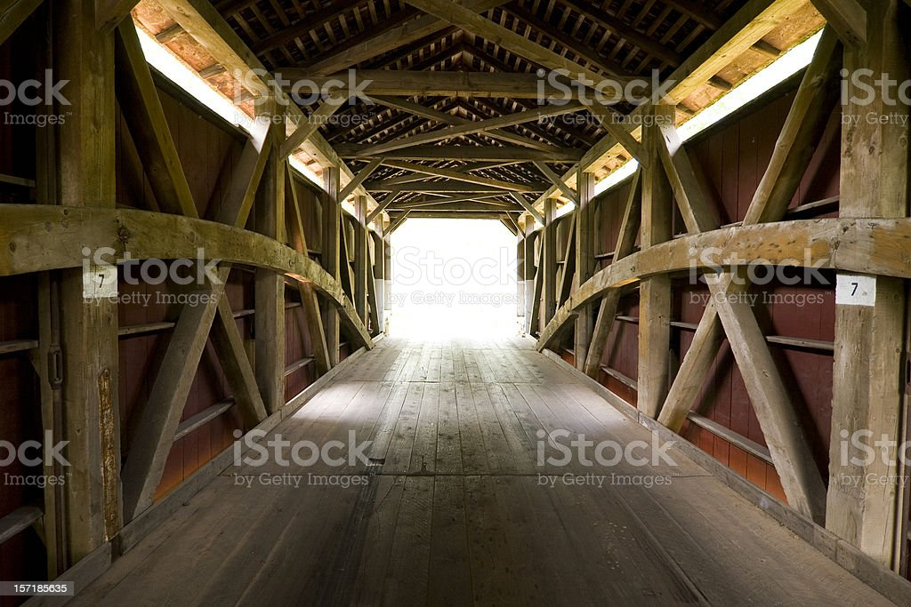 Covered bridge in Amish county towards the light royalty-free stock photo