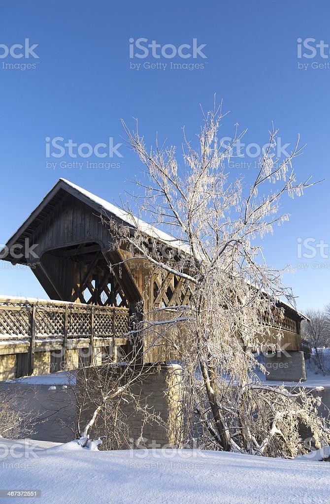Covered Bridge on Snowy Winter Day stock photo