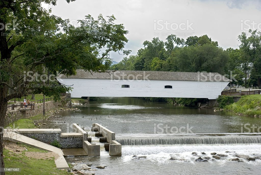 Covered Bridge Over River With Dam & Fish Ladder Horizontal stock photo