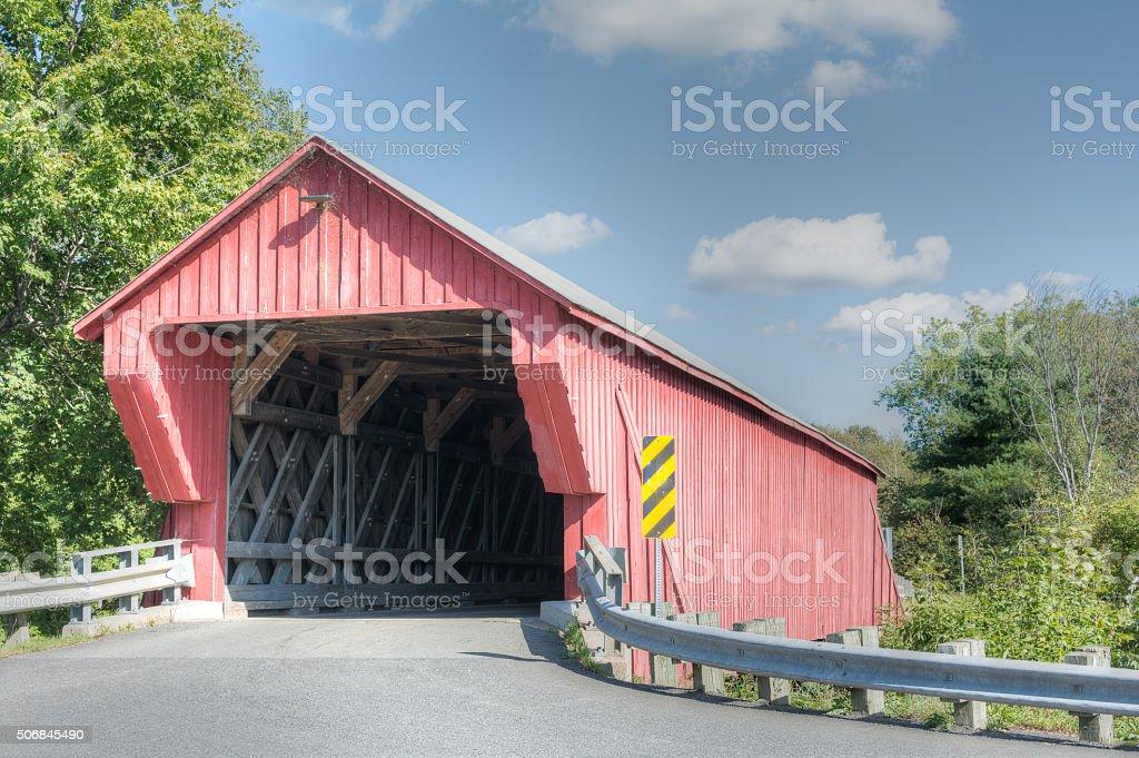 Covered bridge road stock photo