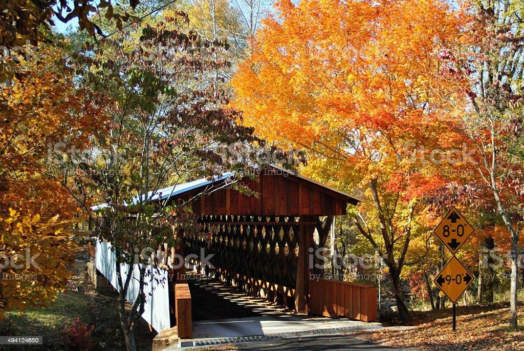 Covered Bridge With Fall Foliage stock photo