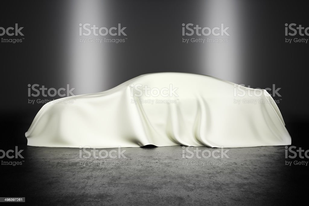 Covered car with studio lighting royalty-free stock photo