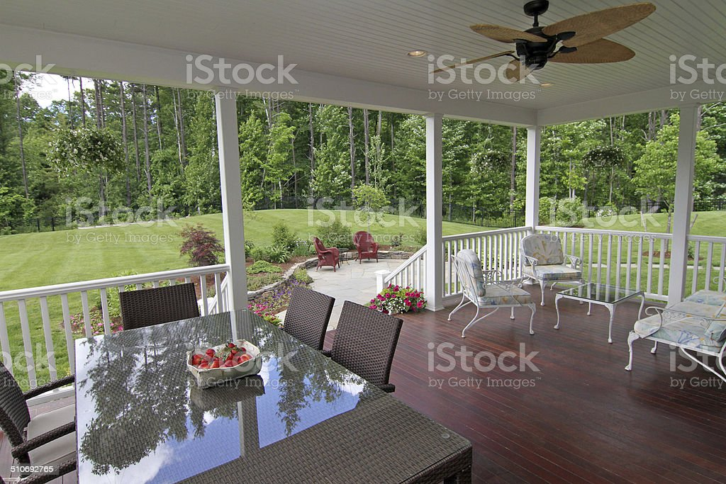 Large deck for entertaining with ceiling fan and overhead lighting,...