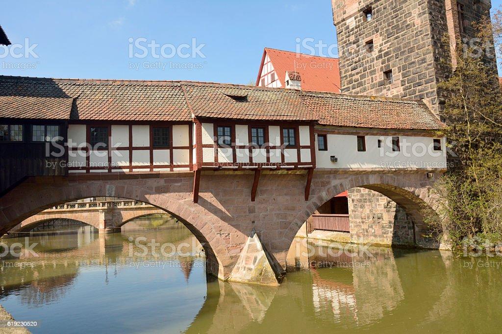 Covered Henkersteg bridge in Nuremberg. stock photo