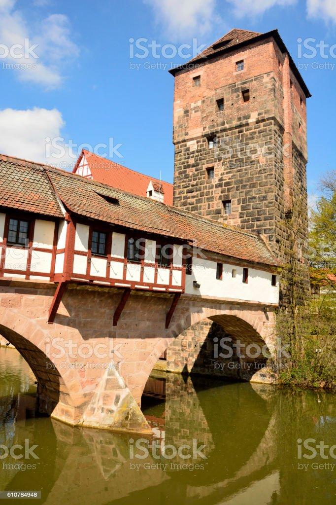Covered Henkersteg bridge with adjacent tower in Nuremberg. stock photo
