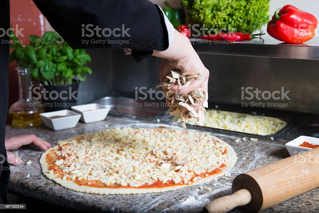 Covered pizza with cheese stock photo
