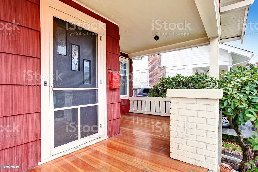 Covered porch of craftsman old American house. stock photo