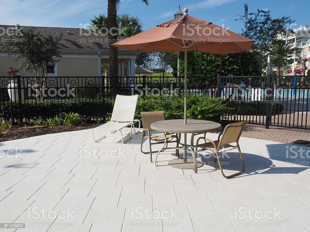 covered table and chairs stock photo