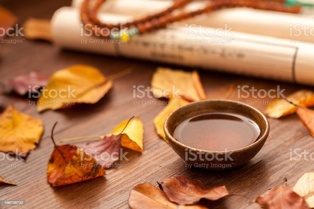 Covered with fallen leaves in autumn, Chinese tea and Book stock photo