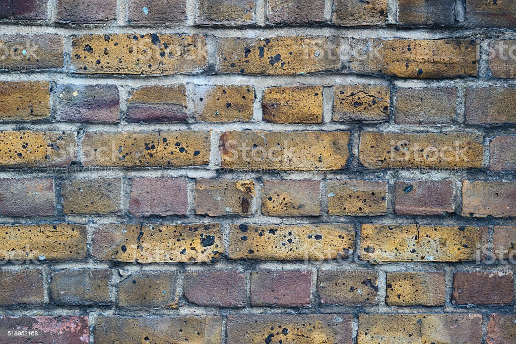 Covered with soot brick wall stock photo