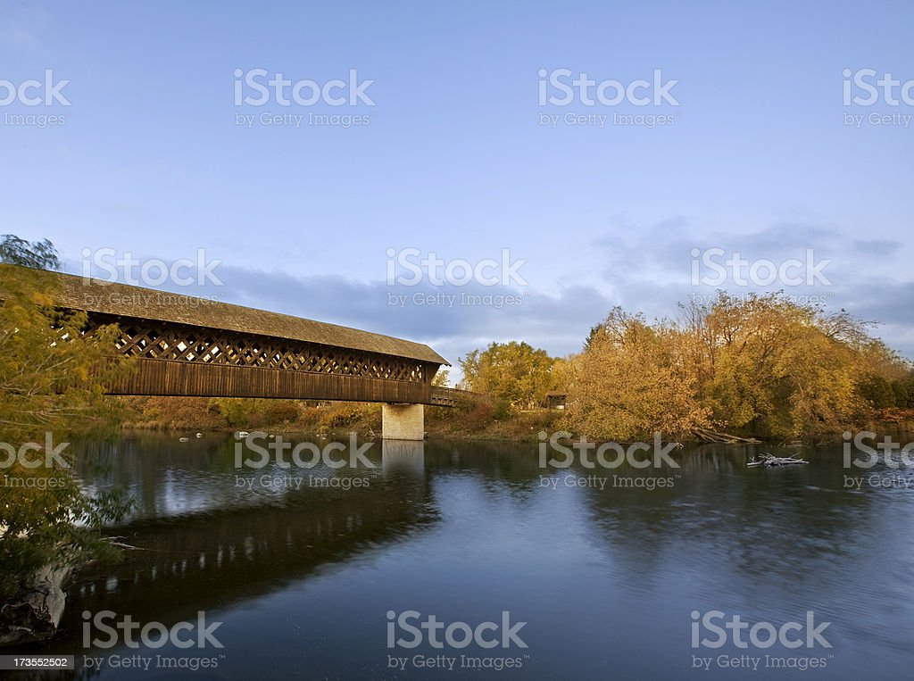 Covered Wooden Bridge above River stock photo
