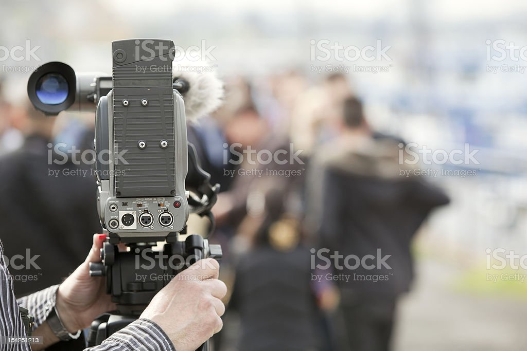 Covering an event with a video camera royalty-free stock photo