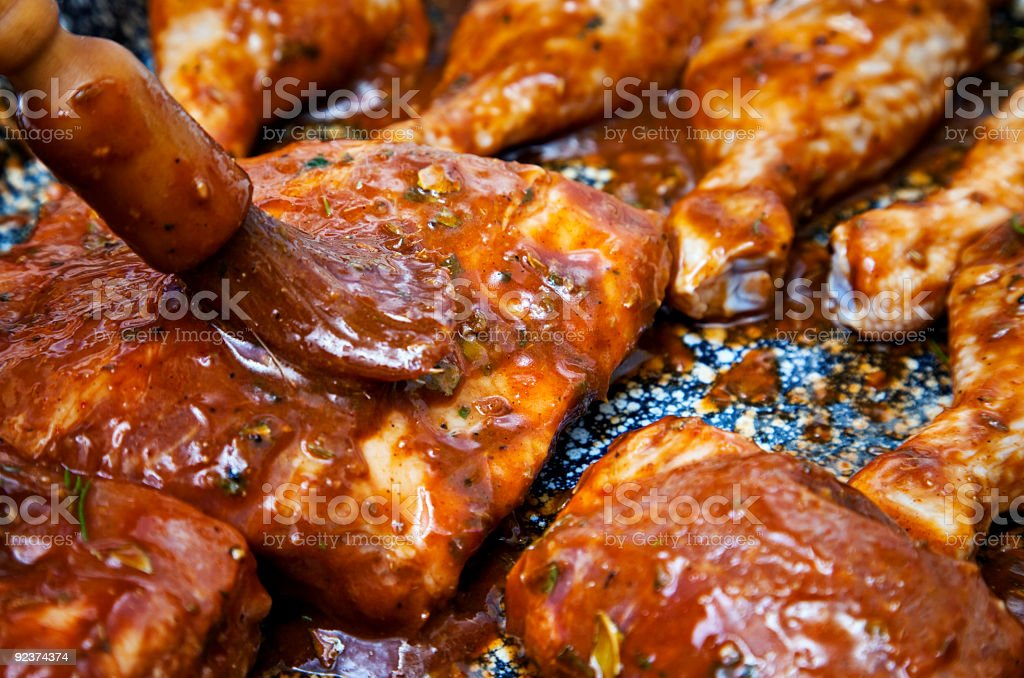 Covering Back ribs in marinade stock photo
