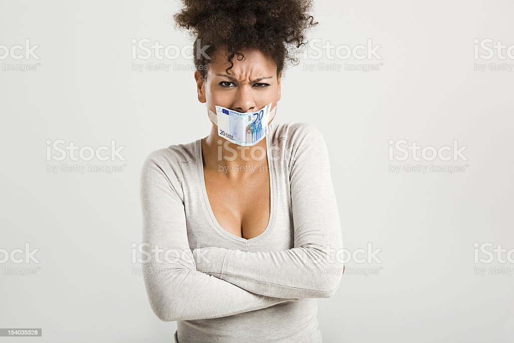 Covering mouth with a euro banknote royalty-free stock photo