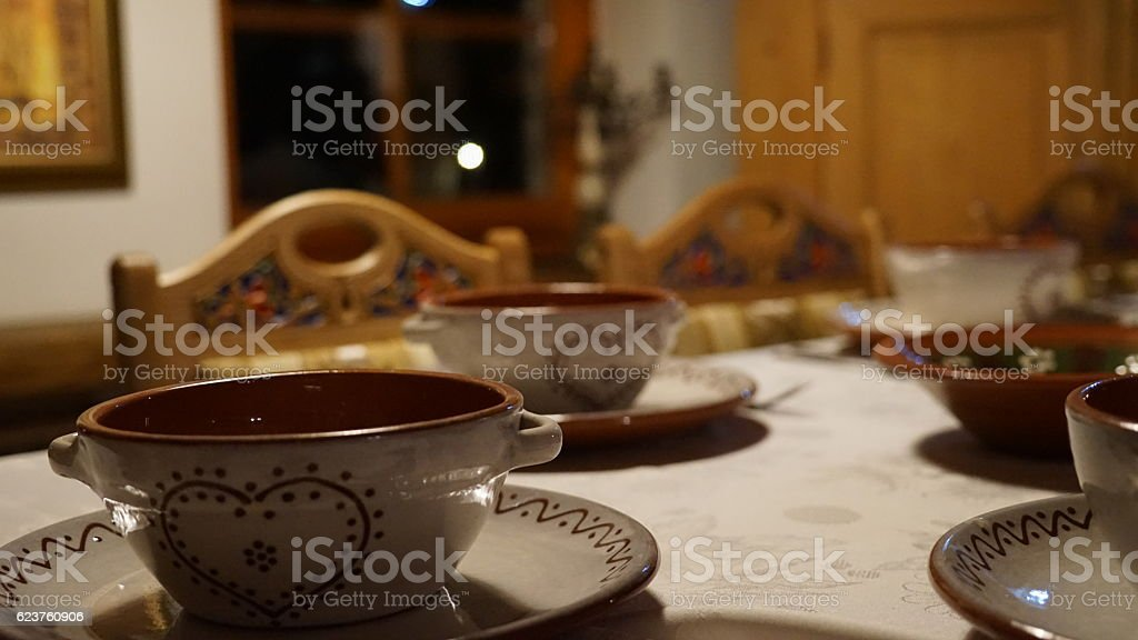 Covering the Christmas table traditionally decorated clay vessels in the heart stock photo