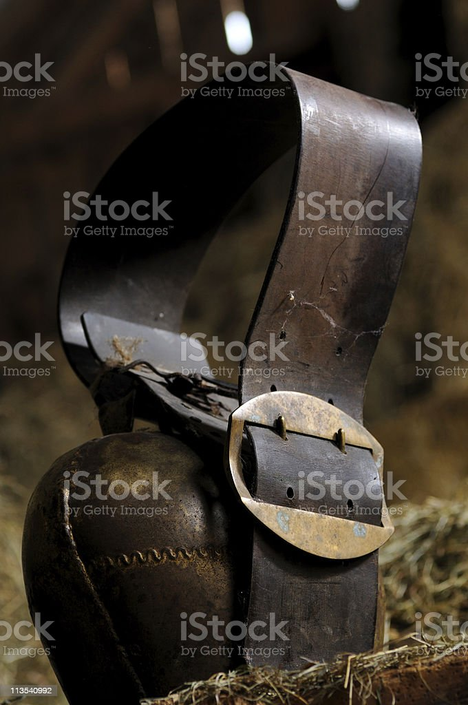 Cow bell in a barn stock photo