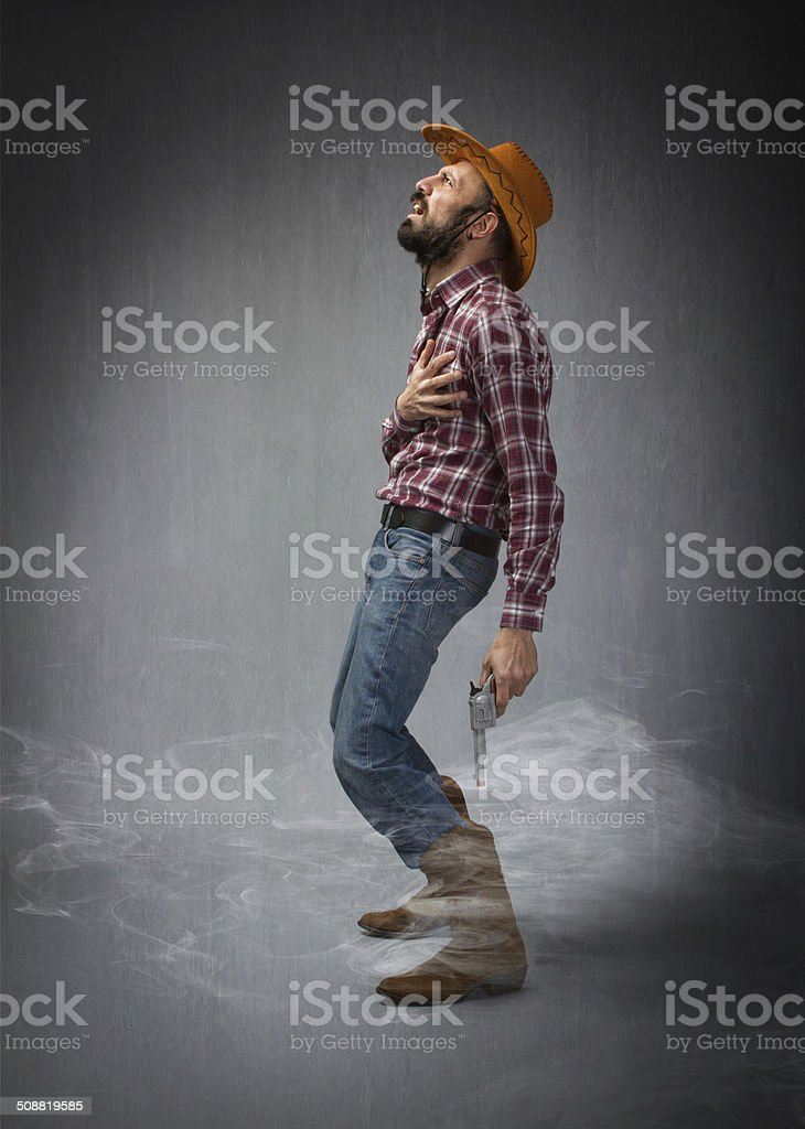 cow boy hitting and death stock photo