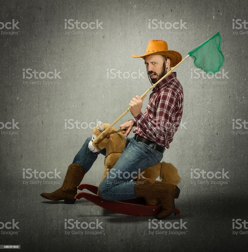 cow boy or butterfly collector stock photo