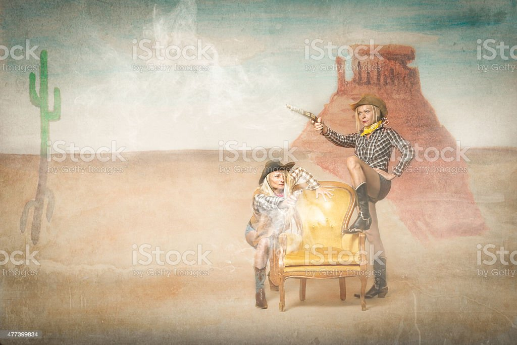 cow boy shooting in a western situation stock photo