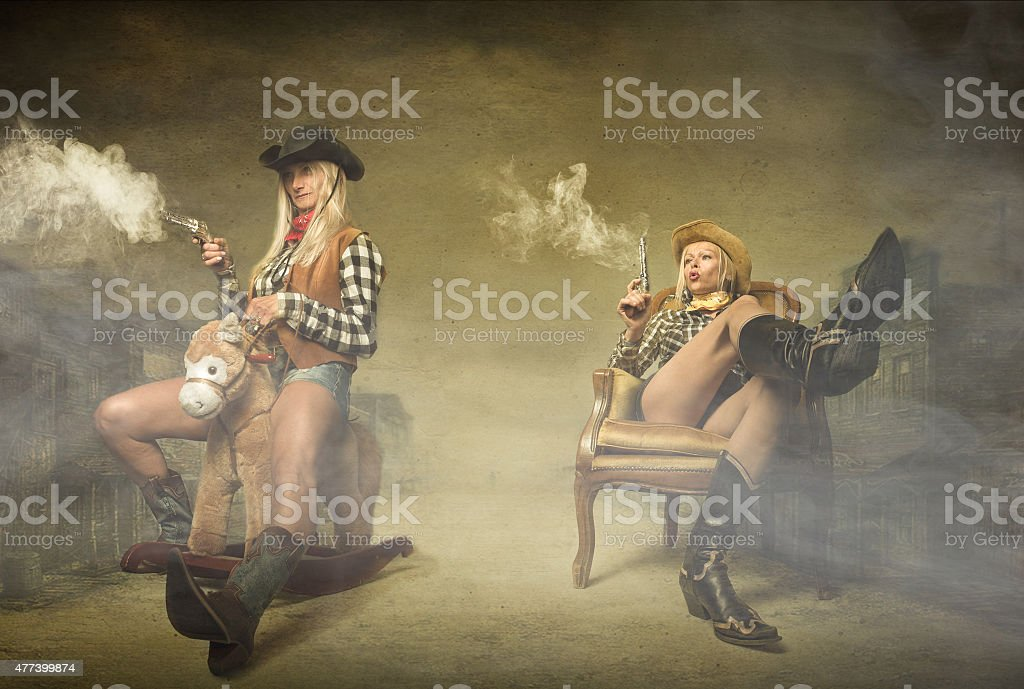cow boy shooting with guns on hands stock photo