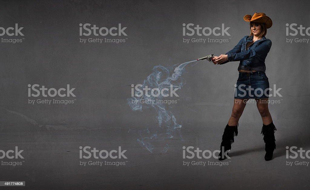 cow boy shot with smoking gun stock photo