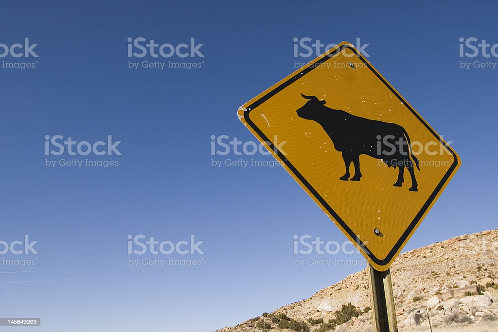 Cow Crossing Sign off Route 66 in New Mexico royalty-free stock photo
