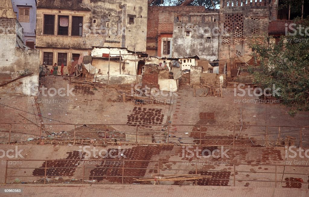 Cow dung drying in the sun, Varanassi, India. stock photo