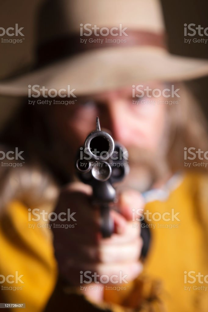 Cowboy Aiming Pistol royalty-free stock photo