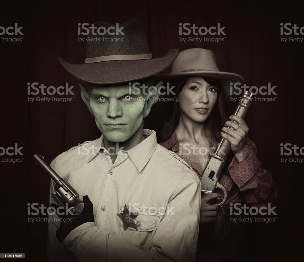 Cowboy and Alien stock photo