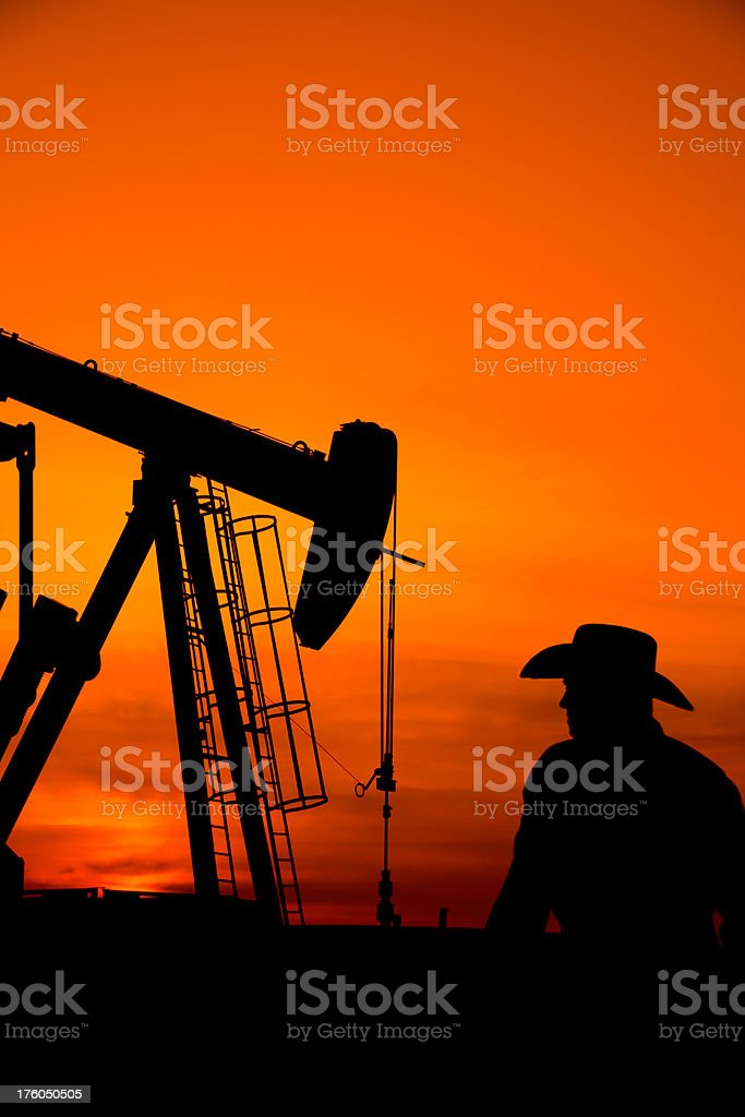 Cowboy and an Oil Derrick royalty-free stock photo