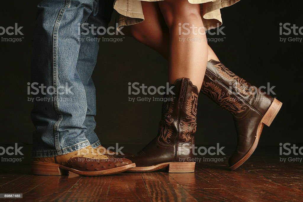 Cowboy and cowgirl together stock photo