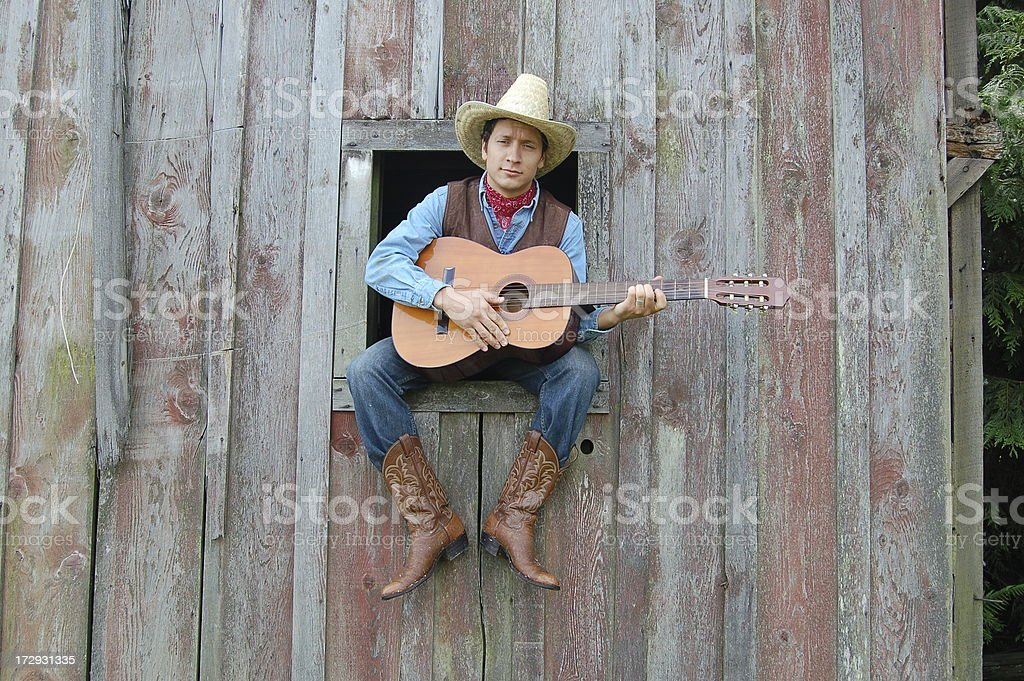 Cowboy and Guitar in Window stock photo