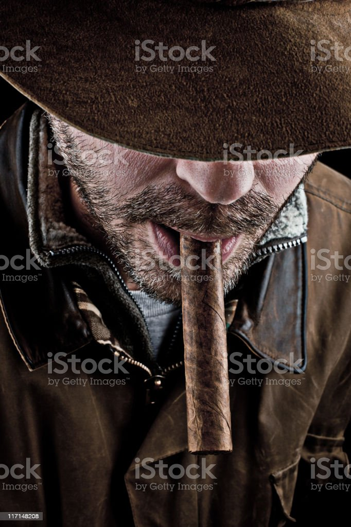 Cowboy and his cigar royalty-free stock photo