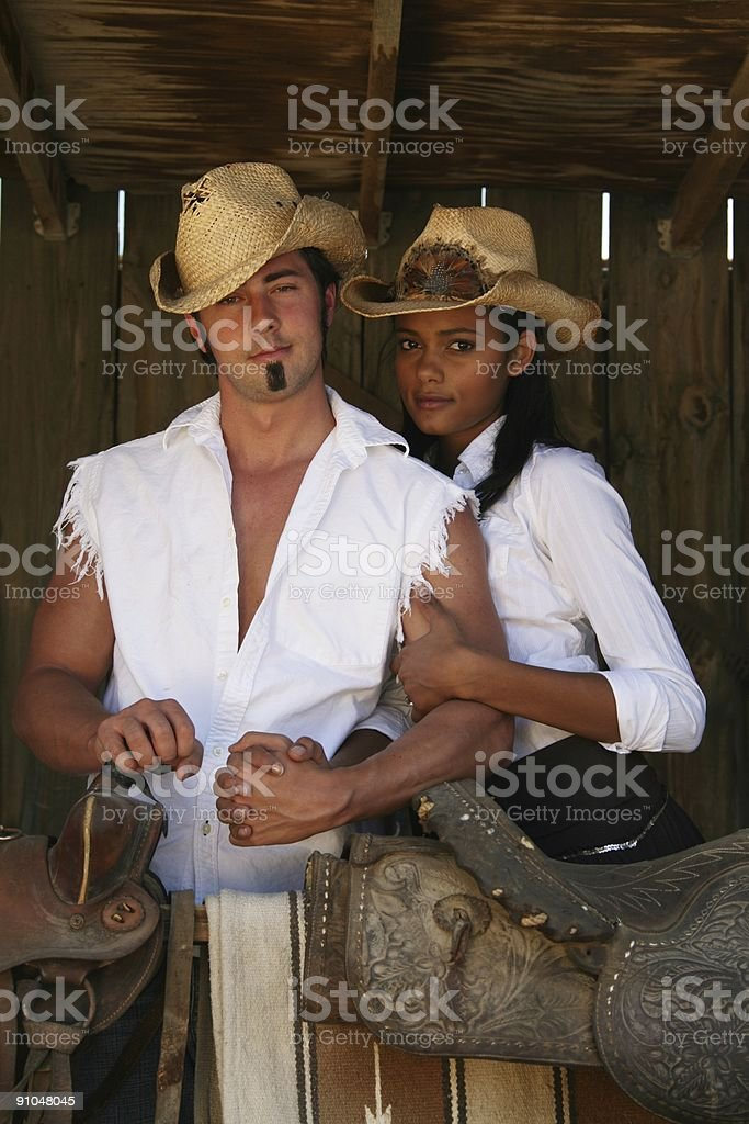 Cowboy and his girl. stock photo