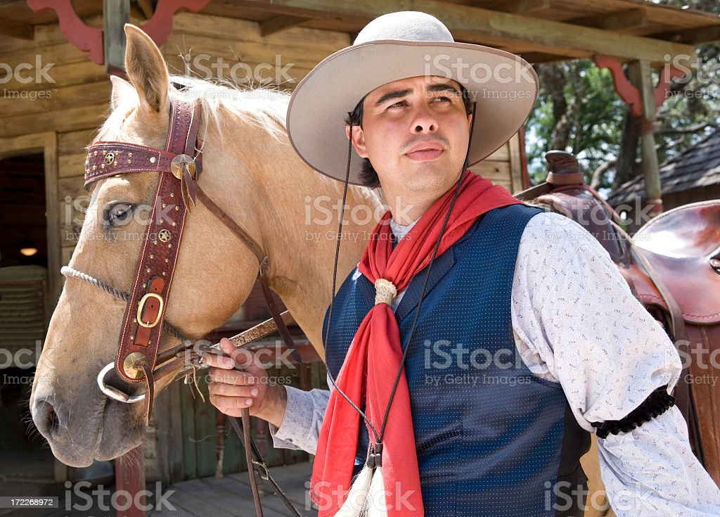 Cowboy and His Horse stock photo