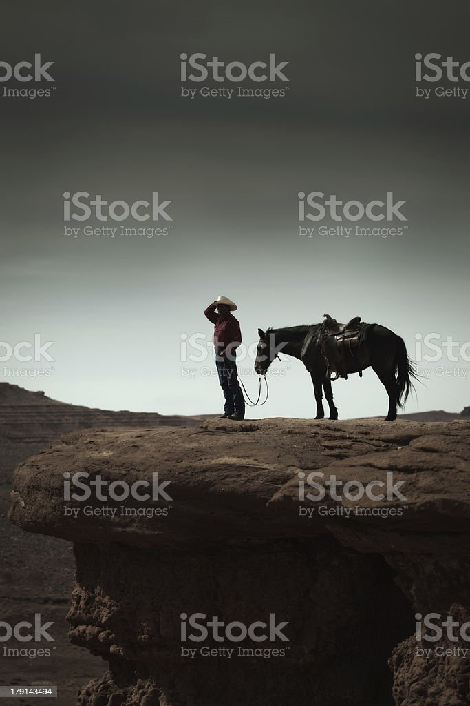 Cowboy and Horse in the American Southwest Landscape Vertical royalty-free stock photo
