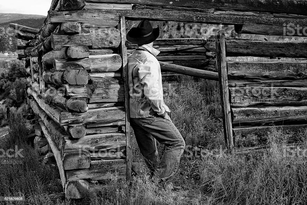 Cowboy and Old Cabin at Dusk with Stars Black White stock photo