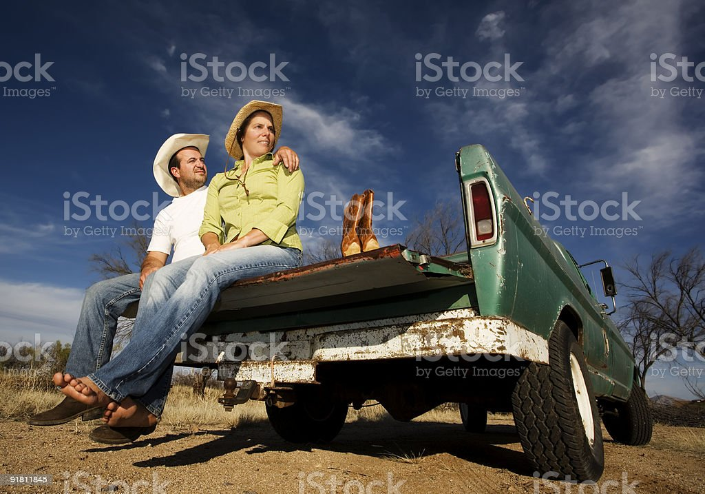 Cowboy and woman on pickup truck royalty-free stock photo