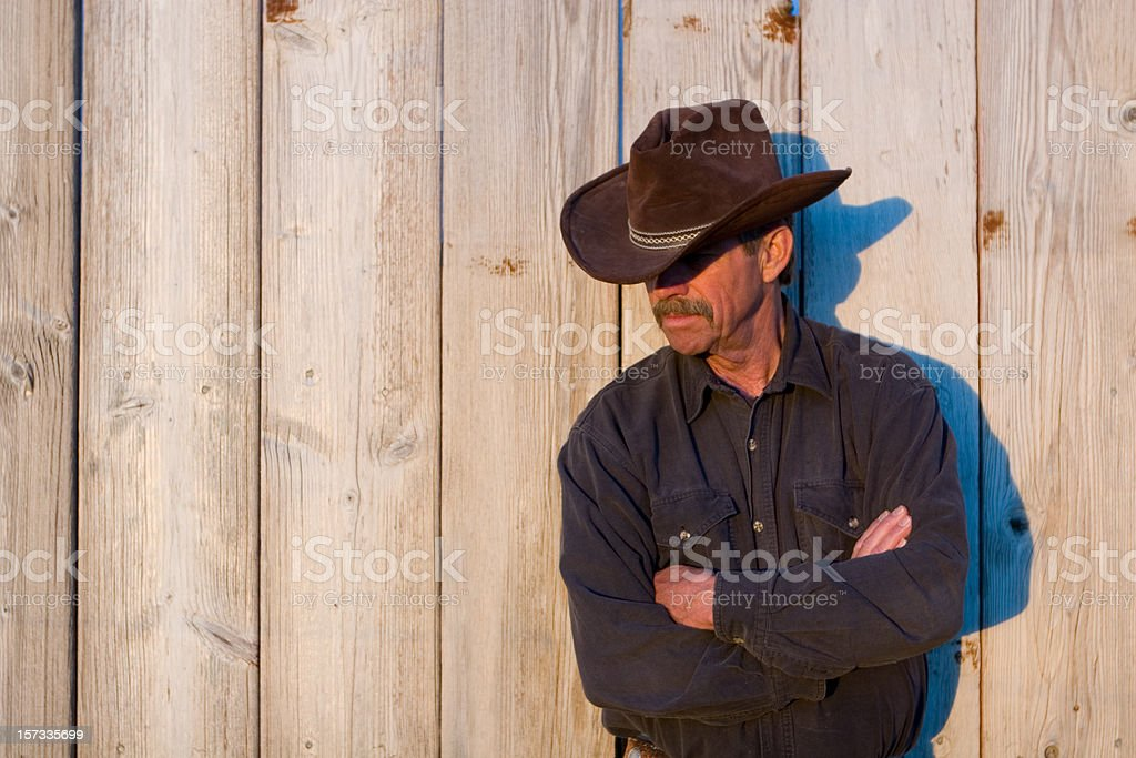 Cowboy and Wooden Wall royalty-free stock photo