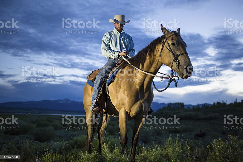 Cowboy at dusk stock photo