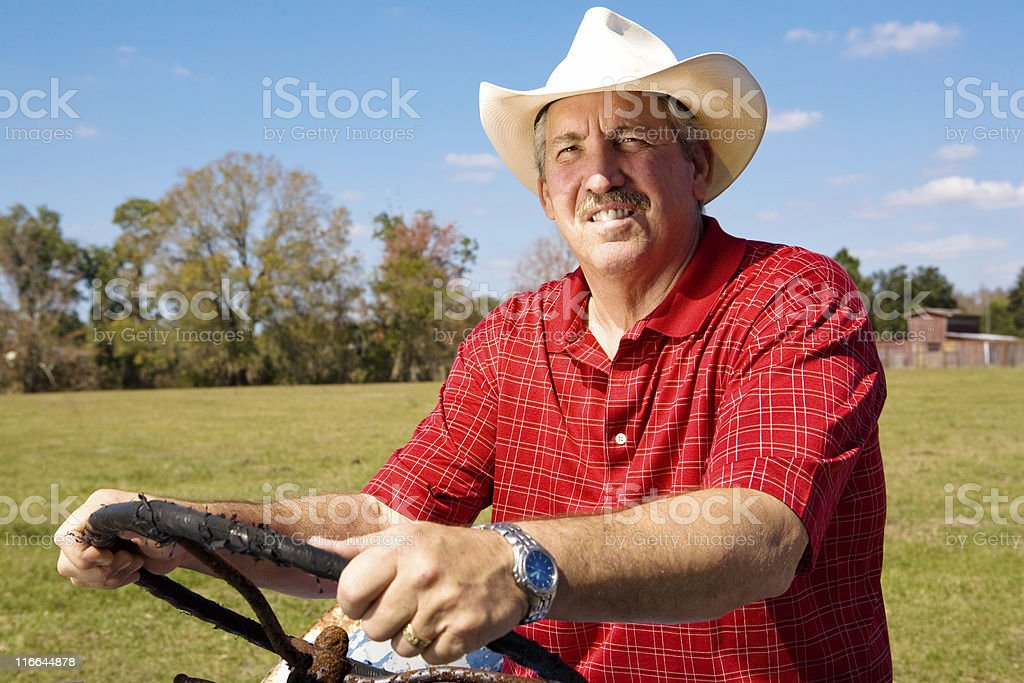 Cowboy at the Wheel stock photo