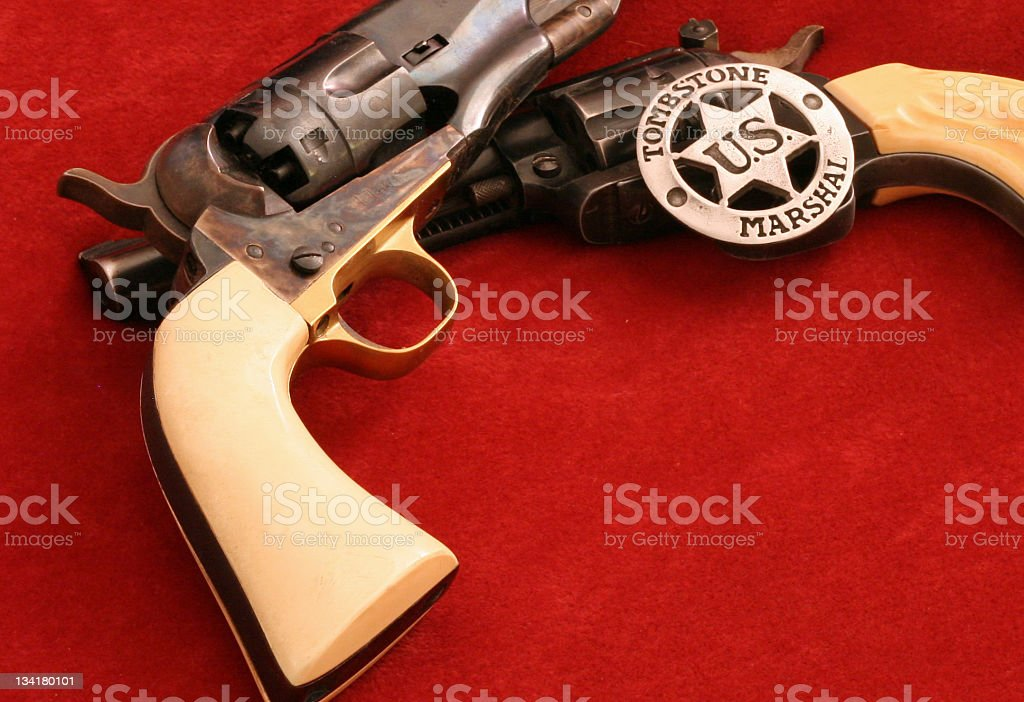 Cowboy Badge and guns stock photo