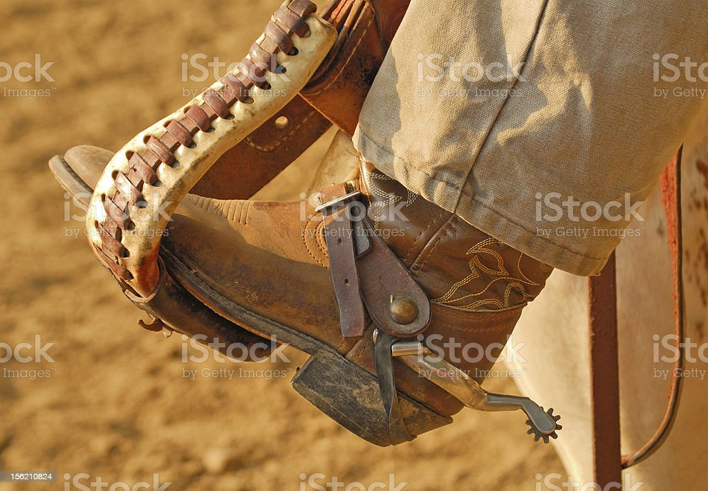 Cowboy boot in stirrup stock photo