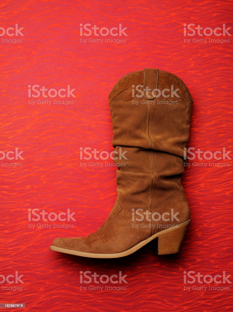 Cowboy Boot on Red Paper stock photo