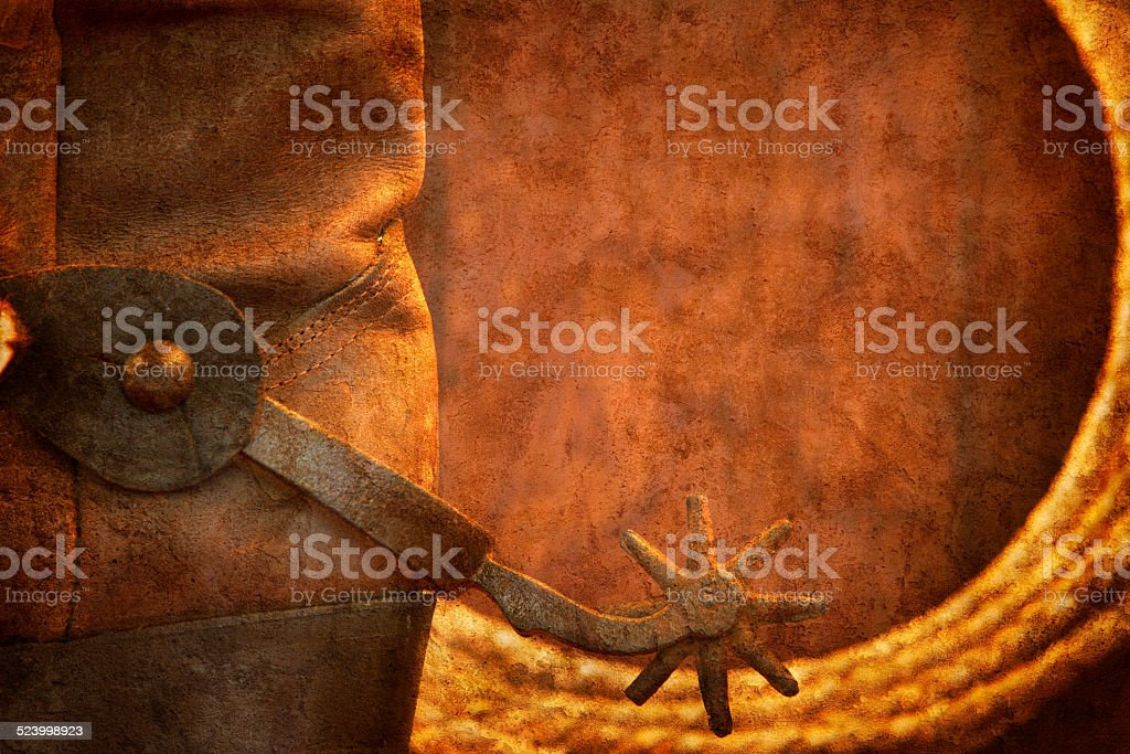 Cowboy Boot With Spur And Lasso On Wood Surface stock photo