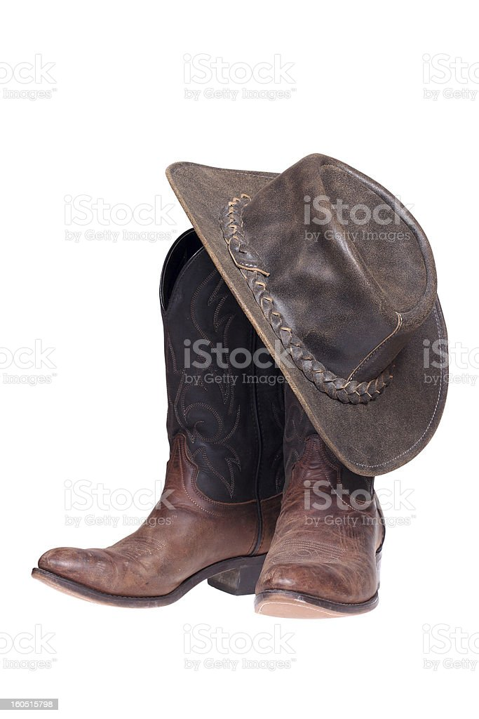 Cowboy boots and hat on a white background stock photo