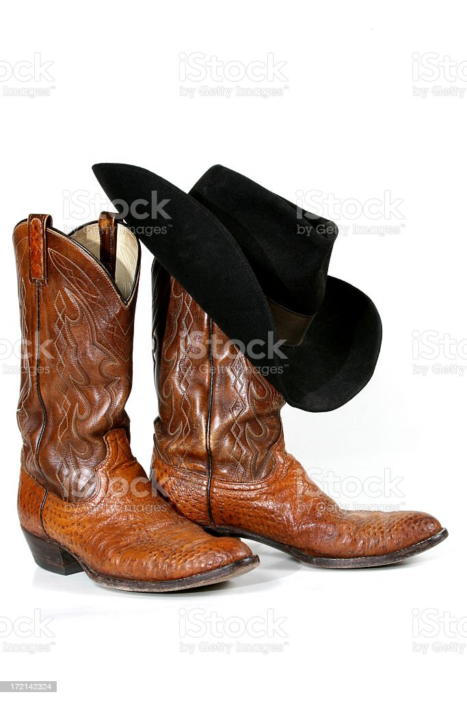 Cowboy boots and hat on white background stock photo